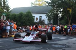 Race cars return to the track after the concours 1974 Lola T332