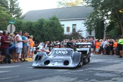 Race cars leave town after the concours 1974 Shadow DN5