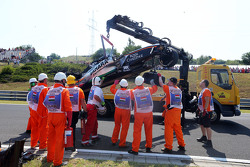 Marshals recover the Sahara Force India F1 VJM08 of Sergio Perez, after he crashed in the first practice session