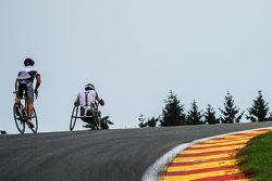 Timo Glock and Alex Zanardi ride on the circuit