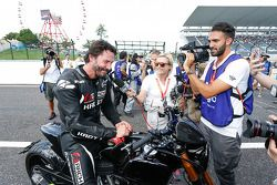 Keanu Reeves rides his motorcycle around Suzuka