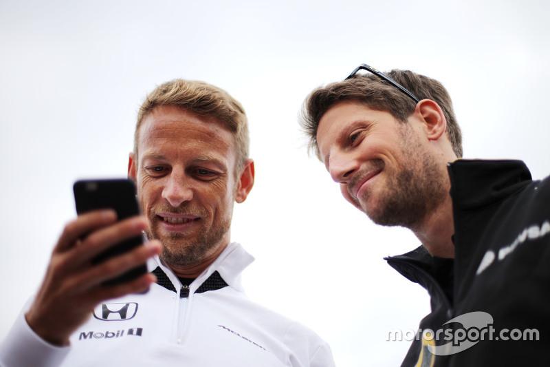 Jenson Button, McLaren Honda; Romain Grosjean, Lotus F1 Team