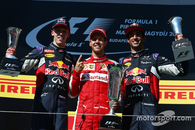 Podium: second place Daniil Kvyat, Red Bull Racing and winner Sebastian Vettel, Ferrari and third place Daniel Ricciardo, Red Bull Racing