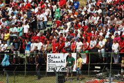 Fans observe the pre-race tribute to Jules Bianchi