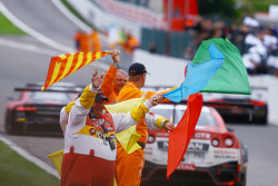 Marshals wave flags at the finish
