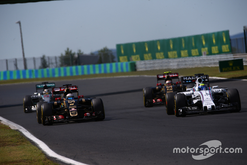 Romain Grosjean, Lotus F1 E23 and Felipe Massa, Williams FW38