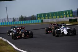 Ромен Грожан, Lotus F1 E23 (слева), и Фелипе Масса, Williams FW37