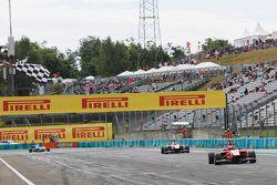 Kevin Ceccon, Arden International, takes the chequered flag ahead of Esteban Ocon, ART Grand Prix an