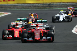 Sebastian Vettel, Ferrari SF15-T leads behind the FIA Safety Car
