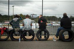 Fans sit on tires