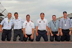 Chris Helein, Dave Alpern, J.D. Gibbs, Joe Gibbs, Todd Meredith, Byron Goggin, Joe Gibbs Racing celebrate at the yard of bricks