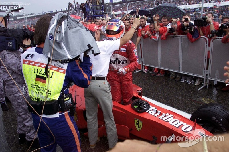 Michael Schumacher greets race winner Rubens Barrichello, Ferrari in parc ferme