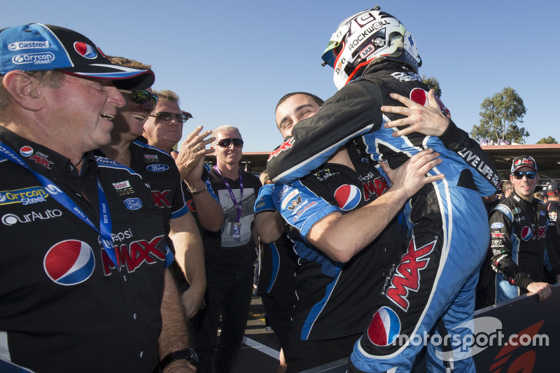Race winner Chaz Mostert celebrating with his team, Prodrive Racing Australia Ford