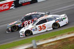 Matt Dibenedetto, BK Racing Toyota y Cole Whitt, Front Row Motorsports Ford