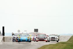 Start: #13 Rum Bum Racing Porsche 997: Matt Plumb, Hugh Plumb leads