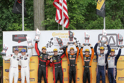 Class winners podium: P class winners #31 Action Express Racing Corvette DP: Eric Curran, Dane Cameron, PC class winners #11 RSR Racing Oreca FLM09 Chevrolet: Chris Cumming, Bruno Junqueira, GTLM class winners #911 Porsche Team North America Porsche 911 RSR: Nick Tandy, Patrick Pilet, GTD class winners #33 Riley Motorsports SRT Viper GT3-R: Ben Keating, Jeroen Bleekemolen