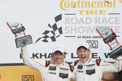 GTLM podium: winners #911 Porsche Team North America Porsche 911 RSR: Nick Tandy, Patrick Pilet