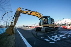 Race winner Joey Logano, Team Penske assists with the start of repaving work