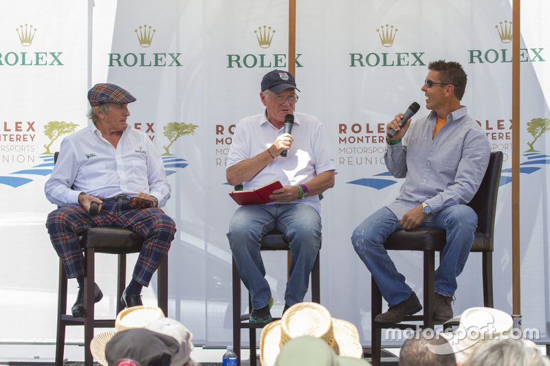 Sir Jackie Stewart y Scott Pruett con el moderador, Murray Smith