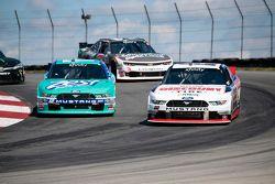 Alex Tagliani, Team Penske Ford y Chris Buescher, Roush Fenway Racing Ford