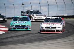 Alex Tagliani, Team Penske Ford and Chris Buescher, Roush Fenway Racing Ford