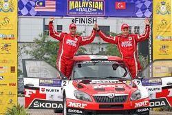 Winner: Pontus Tidemand and Emil Axelsson, Skoda Fabia S2000, Team MRF celebrate their victory in th