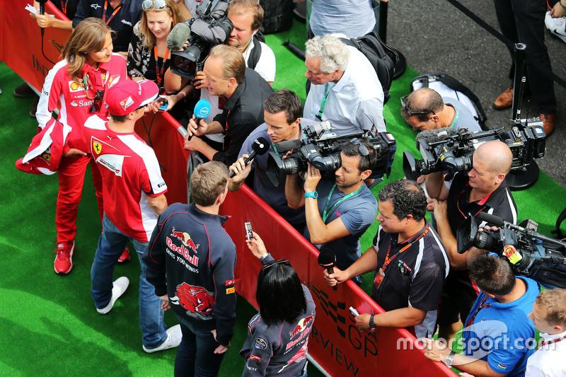 (L to R): Kimi Raikkonen, Ferrari and Max Verstappen, Scuderia Toro Rosso with the media