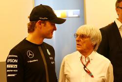 (L to R): Nico Rosberg, Mercedes AMG F1 with Bernie Ecclestone,