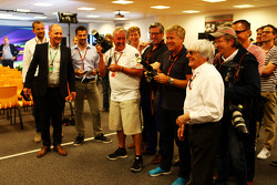 Bernie Ecclestone, joins the photographers
