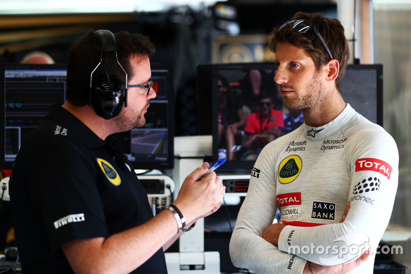 (L to R): Julien Simon-Chautemps, Lotus F1 Team Race Engineer with Romain Grosjean, Lotus F1 Team