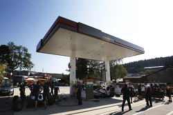 Trident and ART Grand Prix teams practice pitstops in a petrol station forecourt