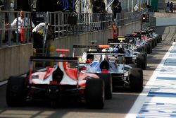 GP3 cars line up in the pit lane