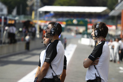 ART Grand Prix mechanics watch qualifying on a big screen from the pit lane