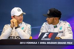 (L to R): Nico Rosberg, Mercedes AMG F1 with team mate Lewis Hamilton, Mercedes AMG F1 in the FIA Press Conference