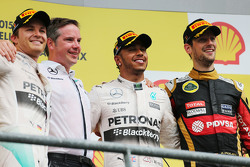 Podium: Romain Grosjean, Lotus F1 Team, second; Lewis Hamilton, Mercedes AMG F1, race winner; Romain Grosjean, Lotus F1 Team, third