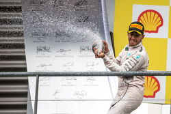 Race winner Lewis Hamilton, Mercedes AMG F1 celebrates with the champagne on the podium