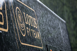 Lotus F1 Team truck and logo in a post race rain storm