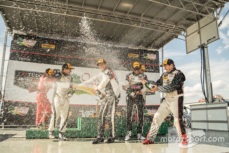 Podium: Race winners #17 RS1 Porsche Cayman: Spencer Pumpelly, Luis Rodriguez Jr., second place #56