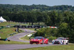 #63 Scuderia Corsa Ferrari 458 Italia: Bill Sweedler, Townsend Bell and #25 BMW Team RLL BMW Z4 GTE: Bill Auberlen, Dirk Werner
