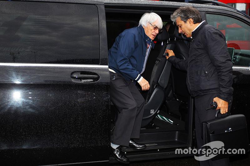 Bernie Ecclestone with Pasquale Lattuneddu of the FOM