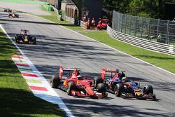 Kimi Raikkonen, Ferrari SF15-T and Carlos Sainz Jr., Scuderia Toro Rosso STR10