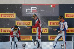 Race 2 Podium: second place Esteban Ocon and winner Marvin Kirchhofer, ART Grand Prix and third place Luca Ghiotto, Trident
