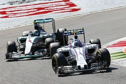 Valtteri Bottas, Williams FW37 and Nico Rosberg, Mercedes AMG F1 W06 battle for position