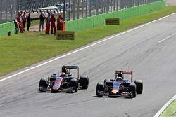 Jenson Button, McLaren MP4-30 and Max Verstappen, Scuderia Toro Rosso STR10