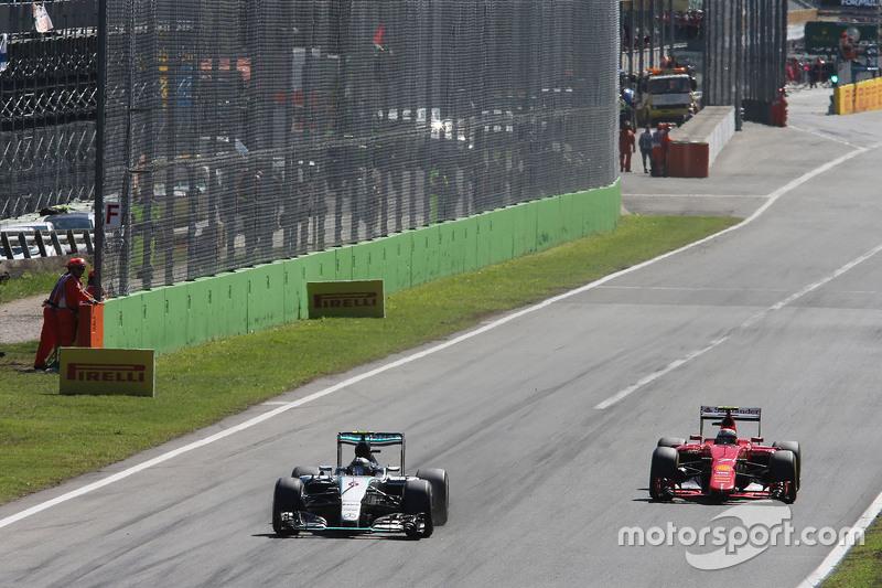 Ніко Росберг, Mercedes AMG F1 W06 та Кімі Райкконен, Ferrari SF15-T
