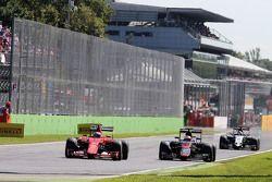 Kimi Raikkonen, Ferrari SF15-T and Jenson Button, McLaren MP4-30