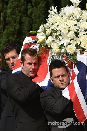 Mark Webber helps carry the casket of Justin Wilson during funeral proceedings