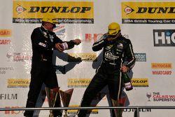 Jason Plato and Tom Ingram celebrate on the podium
