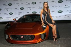 Naomi Harris ( James Bond Spectre, Miss Moneypenny )next to a Jaguar C-X75 during the presentation of the Jaguar Land Rover vehicles starring in the new Bond film Spectre