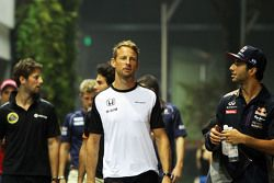 Jenson Button, McLaren with Daniel Ricciardo, Red Bull Racing